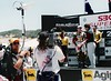 David Bounds keeps my microwave pointed at the catcher [receiving antenna] while I shoot Ralph Shaheen interviewing the winners of the World Superbike race at Laguna Seca Raceway, Monterey, California.<br /> <br /> Photo credit: Heidi Bounds