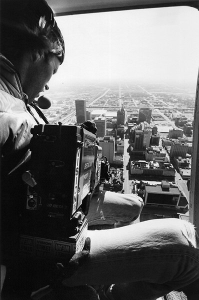 Grabbing some aerial shots of downtown Oklahoma City during the ABA Grand National BMX races. <br /> <br /> Note: The building just above my knee is the Federal Building that was bombed on April 19, 1995<br /> <br /> Photo credit: Wendy Osborne
