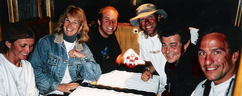 """Having dinner in Russia with some of the best freefall photographers in the world. L-R: Kiwi-Wendy Smith (the most dangerous woman in the world), the late Jan Davis (still my guardian angel), Henry Boger (rare photo of him wearing clothing), myself (with a clean-shaven face), Drop-Dead Ted (our chute packer), and Dave """"Clem"""" Major.<br /> <br /> Photo Credit: David Stanfield"""