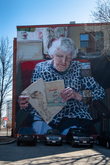 mural of woman with books created by Helen Bur