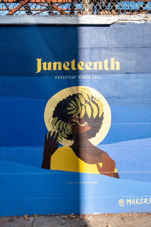 a mural in shadow, Juneteenth