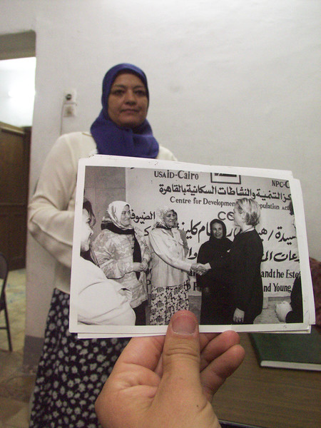 (Oct. 2003 Cairo, Egypt) -- Showing off a photo of Hillary Clinton when she came and gave them computer for the village.<br /> Photo: Michael Rieger