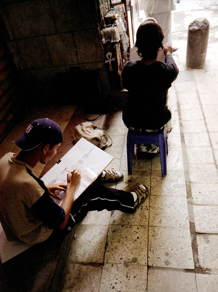 """(Oct,2003 Cairo, Egypt) -- Drawing students from the Unversity work on their assigments in the Bazzarr.<br /> Photo: Michael Rieger<br /> ( <a href=""""http://www.newscorps.com"""">http://www.newscorps.com</a>)<br /> 720-331-6402"""
