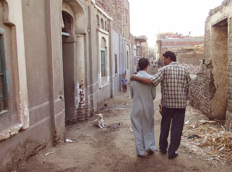(Oct 8,2003 Beni Gnani, Egypt) -- Villagers walk through the streets of Beni Ghani, one of the villages of Hands and CEOSS are doing their work.<br /> Photo: Michael Rieger<br /> 720-331-6402