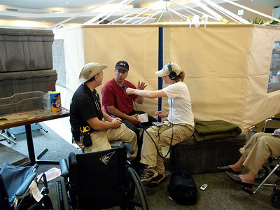 (September 5, 2005 New Orleans) -- NPR's Joe Shapiro with producer Anna Vigran talk with a D-MAT worker about ther experiences at  New Orleans airport where FEMA's D-MATs have set up operations. <br /> Photo: Michael Rieger/FEMA