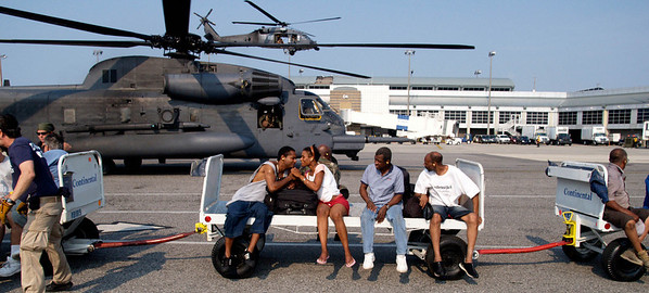 (September 6, 2005 New Orleans) -- Evacuees from the Convention Center arive by helicopter at the  New Orleans airport where FEMA's D-MATs have set up operations.  Photo: Michael Rieger/FEMA