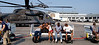 (September 6, 2005 New Orleans) -- Evacuees from the Convention Center arive by helicopter at the  New Orleans airport where FEMA's D-MATs have set up operations. <br /> Photo: Michael Rieger/FEMA