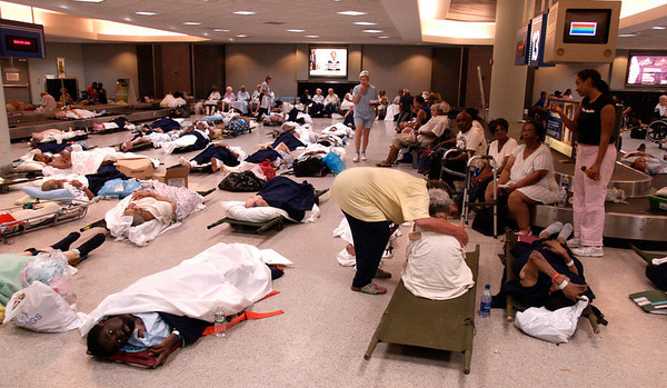 (September 1, 2005 New Orleans) -- Evacuees and hospital patients arrive at New Orleans airport where FEMA's D-MATs have set up operations.  Photo: Michael Rieger/FEMA