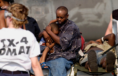 (September 3, 2005 New Orleans) -- Evacuees and patients arive at New Orleans airport where FEMA's D-MATs have set up operations. <br /> Photo: Michael Rieger/FEMA