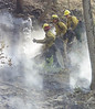 (8-26-2003 Missoula, MT ) -- Fire fighters from ORE-CAL 1 work to secure line on the Fishcreek fire Complex west of Missoula, MT.<br /> Photo: Michael Rieger/FEMA