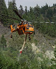 (8-26-2003 Missoula, MT)  --  A Erickson air-crane works putting out hot spots on the FishCreek complex<br /> Photo:  Michael Rieger/FEMA