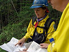 (8-24-2003 Missoula, MT)  --  Hot shot Randi Jandt on the Beta fire checks maps about the placement of fireline in advance of a burn out operation.<br /> Photo:  Michael Rieger/FEMA