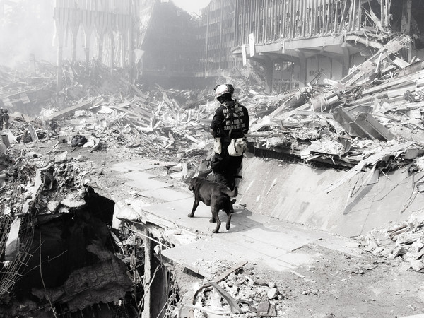 9-21-2001<br /> WA- Task Force -1<br /> Entering ground zero to conduct a search.  This photo was sent to the Oregonian Newspaper to show the people back home what their US&R team was doing.  The image ran front page on 9-22-2001.  Photo: Michael Rieger/FEMA