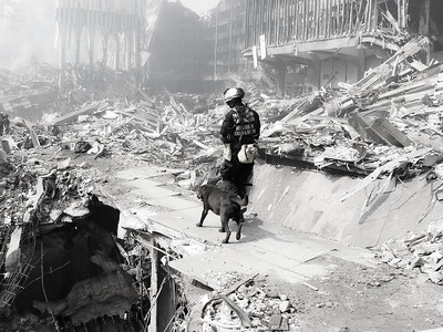 9-21-2001 WA- Task Force -1 Entering ground zero to conduct a search.  This photo was sent to the Oregonian Newspaper to show the people back home what their US&R team was doing.  The image ran front page on 9-22-2001.  Photo: Michael Rieger/FEMA