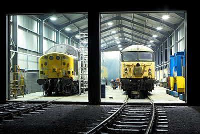 37603 & 56061 undergo repair in the FM Rail shed at Barrow Hill TMD on 12/02/2006. 40145 is just visible behind the polythene sheeting undergoing a repaint.