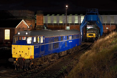 31407 stands in the yard at Barrow Hill TMD with 47769 standing in the roundhouse on 12/02/2006.