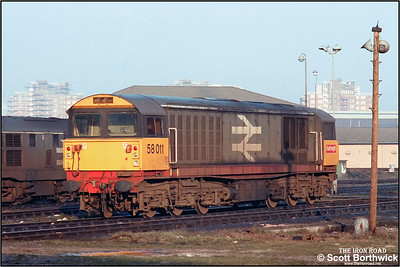 58011 rests between duties at Saltley LIP on 05/02/1986.
