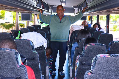 Bob on bus with students