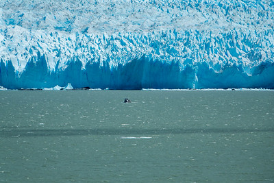 Good perspective of glacier size with boat in foreground