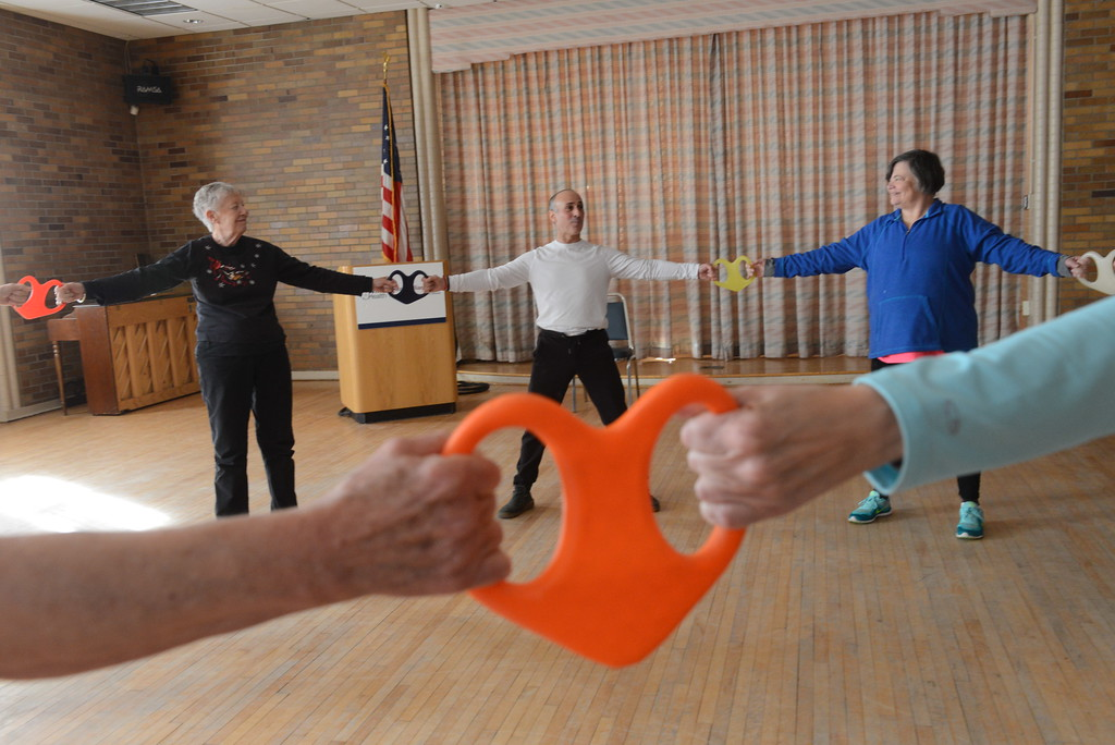 . Paul Widerman of Accord  leads a fitness class with the Oncology Support Group in Kingston, N.Y. Thursday afternoon with his new Heart fitness tool. The tool is used for connecting with oneself, a partner or group and is in the process of being developed with the Hudson Valley Advanced Manufacturing Center at SUNY New Paltz. The group, which meets every Thursday from 9:30-10:30 at the HealthAlliance Admissions Building on Mary\'s Ave in Kingston is open to the publics. Classes are $8.