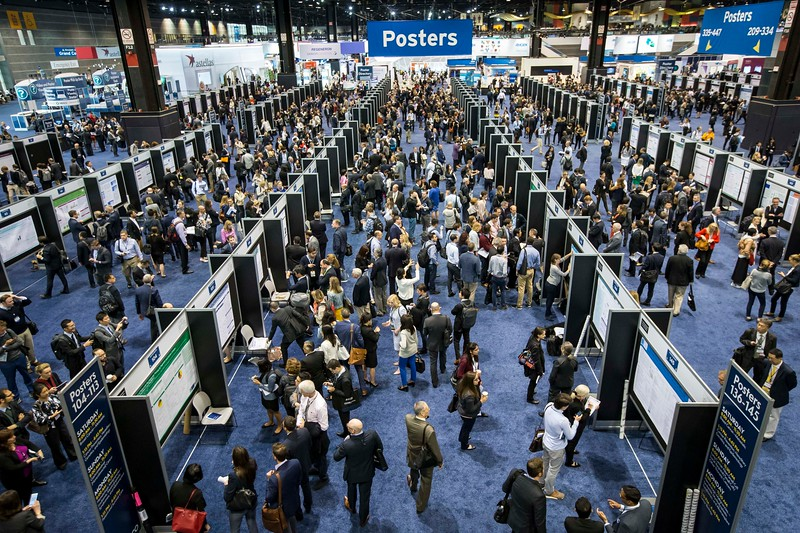 Attendees and poster presenters during Posters Sessions