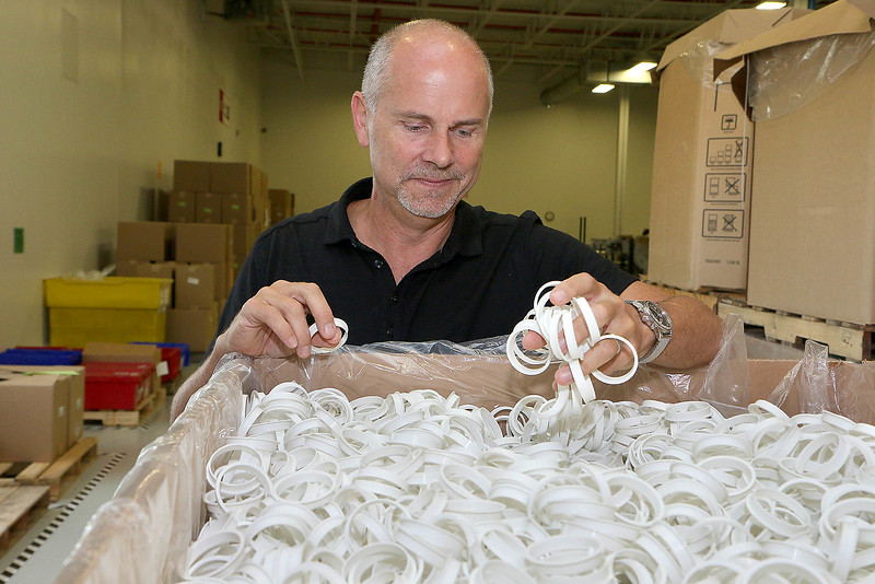 Paul Boudreau the President and CEO of UrthPact a Leominster company talks about their compostable OneCups they are making for San Francisco Bay Gourmet Coffee in California. These will work in most K-Cup style brewers including the Keurig. Boudreau stands next to a box of pod rings, that are part of the construction, as he talks about the OneCup. SENTINEL & ENTERPRISE/JOHN LOVE