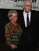 Co-Master of Ceremonies, Grady Mathews with JoAnn (Jansco) McNeal, who accepted induction on behalf of her late father, George Jansco