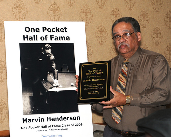 Marvin Henderson's induction plaque and poster was accepted by his friend Dennis Wilson