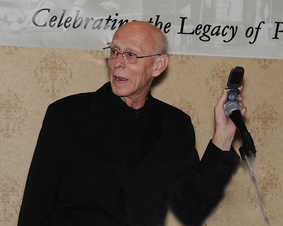 Co-Master of Ceremonies Grady Mathews, holding Billy Incardona's cell phone to the mic with 'Squirrel' on speaker phone