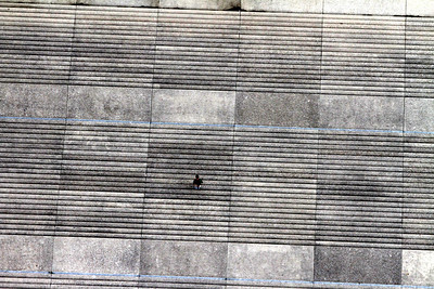 A man walking down the steps