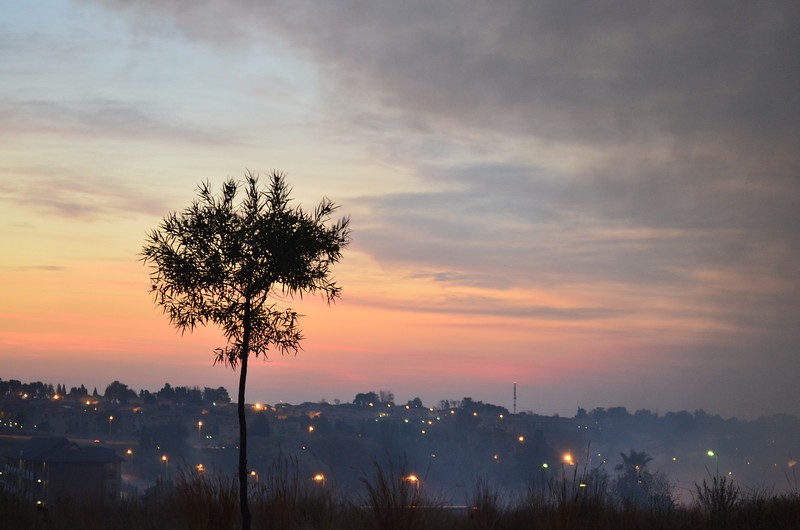Day 25 Highveld sunset and smoke from a burning grass.