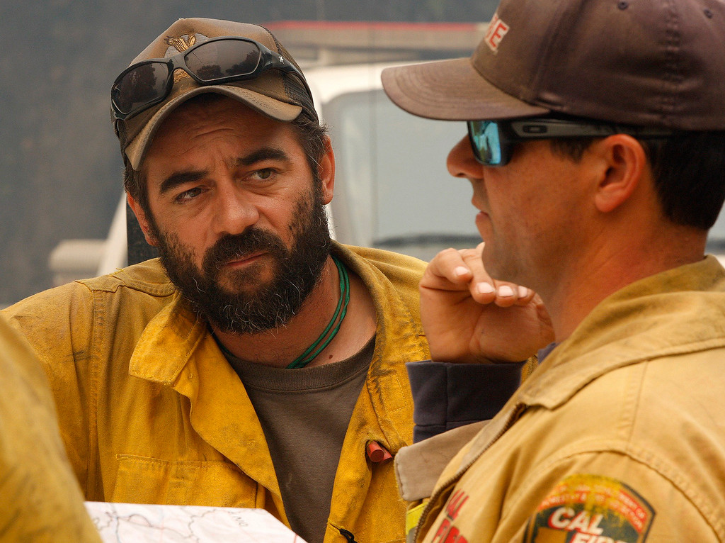 . Cal Fire and USFS fire fighters plan their action in the Palo Colorado Canyon on Friday, July 29, 2016. The Soberanes Fire has burned 31,386 acres with 41 homes destroyed.  (Vern Fisher - Monterey Herald)