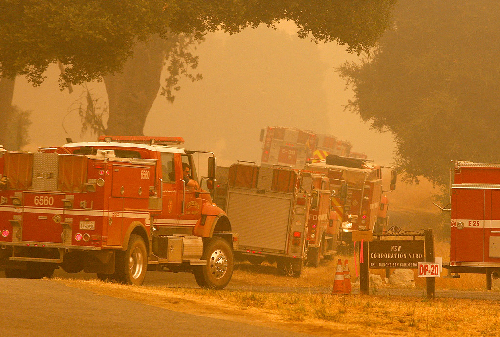 . Strike teams of fire engines make their way in the Rancho San Carlos area of Carmel Valley while fighting the 23,568 acre Soberanes Fire on Wednesday,  July 27, 2016.  (Vern Fisher - Monterey Herald)