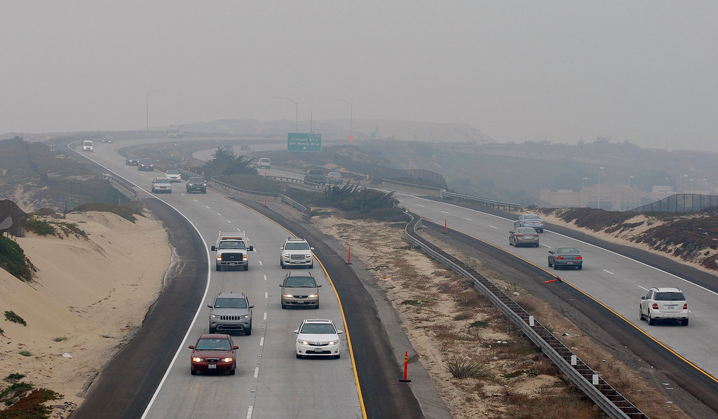 . Cars traveling on Highway 1 through Seaside were using their lights due to the heavy smoke from the Soberanes Fire that has settled over the Monterey Peninsula on Thursday, August 11, 2016.  (Vern Fisher - Monterey Herald)