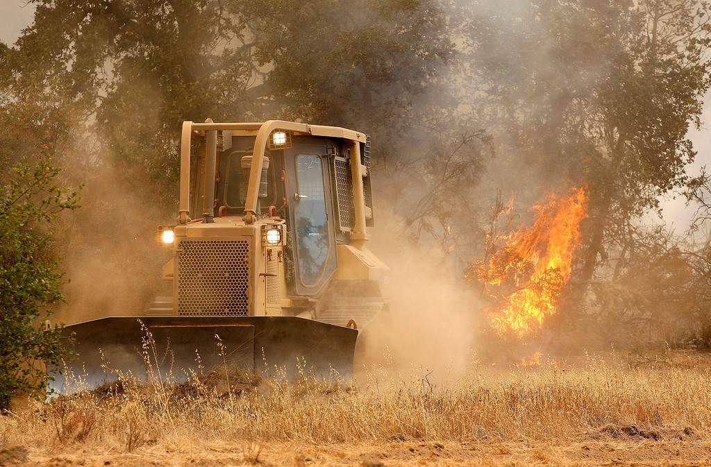 . A private contractor dozer operator works a fire line west of Cachagua on Tuesday, August 2, 2016.  The Soberanes Fire was 45,800 acres and 25% contained  (Vern Fisher - Monterey Herald)