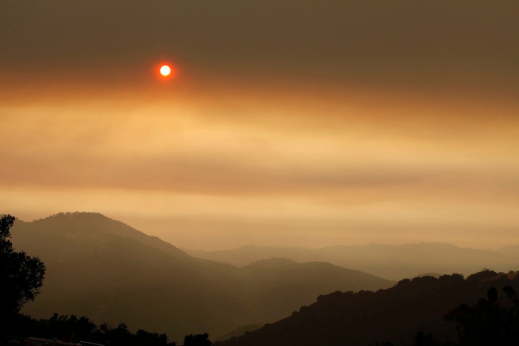 . Heavy drift smoke over Carmel Valley on Sunday, July 31, 2016.   The Soberanes Fire has burned 40,618 acres and 18% contained with 57 homes destroyed.  (Vern Fisher - Monterey Herald)