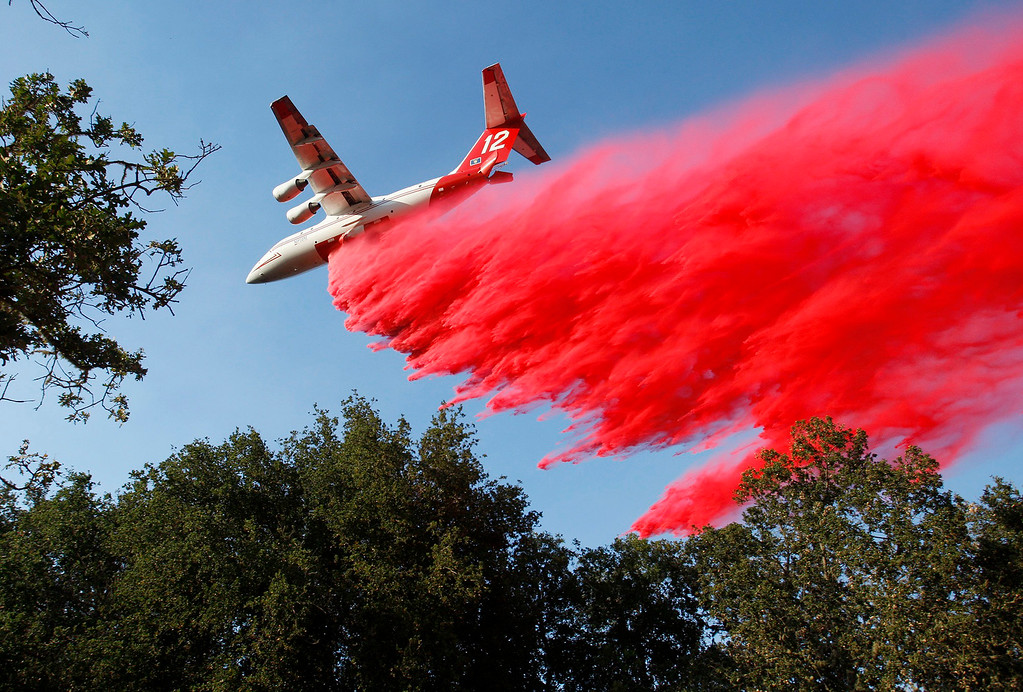 . A air tanker makes a drop of retardant prior to a firing operation west of Cachagua on Tuesday, August 2, 2016.  The Soberanes Fire was 45,800 acres and 25% contained  (Vern Fisher - Monterey Herald)