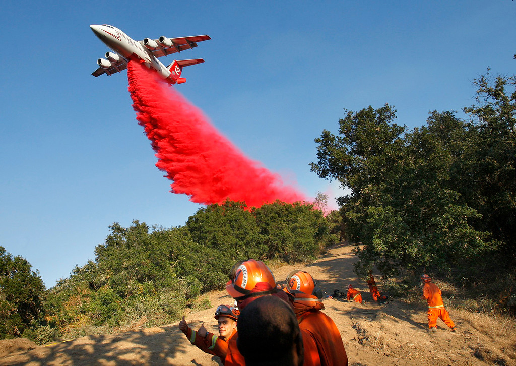 . A air tanker makes a drop of retardant over an inmate fire crew prior to a firing operation west of Cachagua on Tuesday, August 2, 2016.  The Soberanes Fire was 45,800 acres and 25% contained  (Vern Fisher - Monterey Herald)