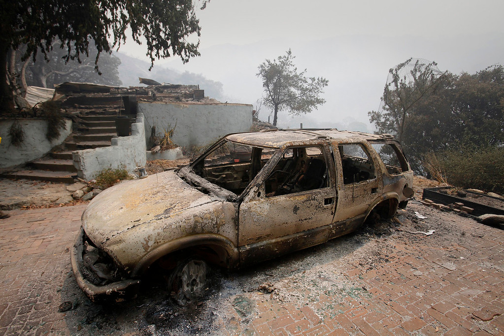. A car and house destroyed on Rock Creek Rd. in the Palo Colorado Canyon on Friday, July 29, 2016.  The Soberanes Fire continues to burn having consumned 31,386 acres and destroyed 41 homes.   (Vern Fisher - Monterey Herald)