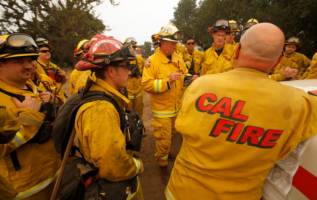 . Cal Fire crews discuss a firing operation west of Cachagua on Tuesday, August 2, 2016.  The Soberanes Fire was 45,800 acres and 25% contained  (Vern Fisher - Monterey Herald)