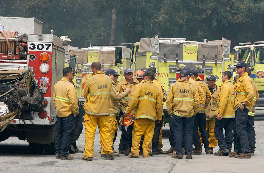 . A strike team from Los Angeles has their morning briefing near the Big Sur River Inn on Friday, August 12, 2016.  The 70,000 acre Soberanes Fire is still buring towards Big Sur and may force the closure of Highway 1 through Big Sur Village.  (Vern Fisher - Monterey Herald)