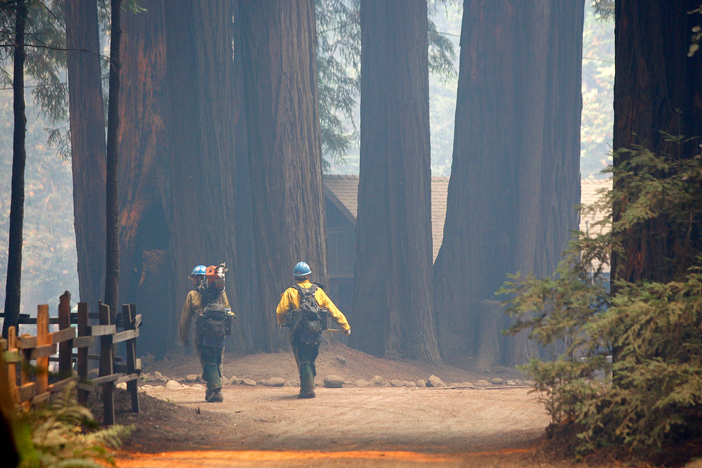 . Members of the Sierra Hot Shots walk through Camp Pico Blanco on Saturday, August 6, 2016.  The scout camp went undamaged from the Soberanes Fire that is currently at 55,600 acres and has a 40% containment.  (Vern Fisher - Monterey Herald)