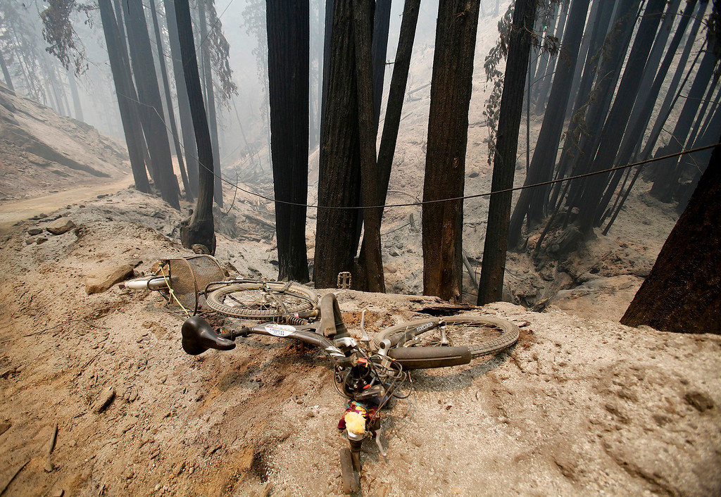 . A bicycle sits next to Rock Creek Rd. in the Palo Colorado Canyon on Friday, July 29, 2016.  The Soberanes Fire continues to burn having consumned 31,386 acres and destroyed 41 homes.   (Vern Fisher - Monterey Herald)