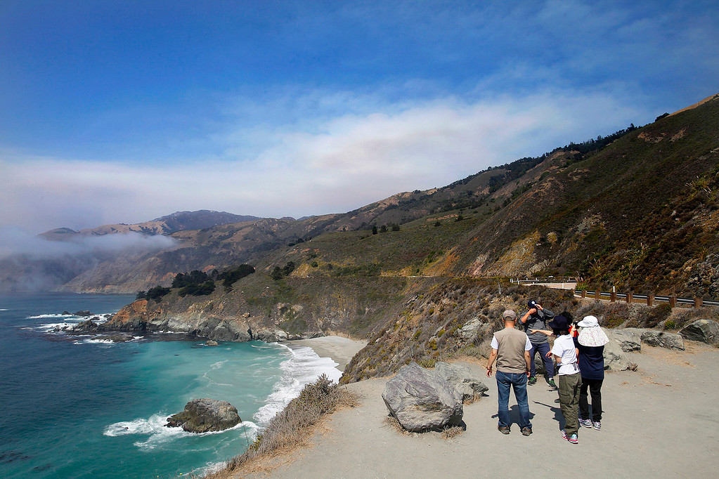 . People view the Soberanes Fire as it burns high on a ridge north of Lucia on Wednesday, Sept. 7, 2016.  (Vern Fisher - Monterey Herald)