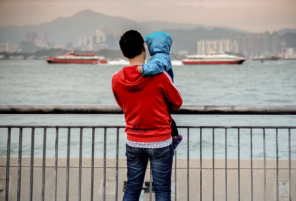 A moment between father & son. Hong Kong. February 2017.