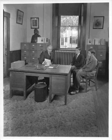 Headmaster Fred C. Gray in his office with students. early 1950s (?). This picture  appeared in several LA publications of the time.
