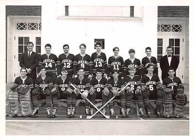 Coach Chuck Duncan with varsity (?) hockey, c. 1967.