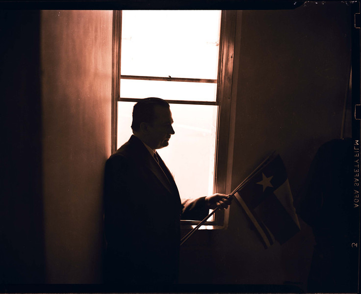 Unlike the windows on the Observation Floor today, in 1939 the windows could open.  Governor W. Lee O'Daniel rests his elbow out of the window.