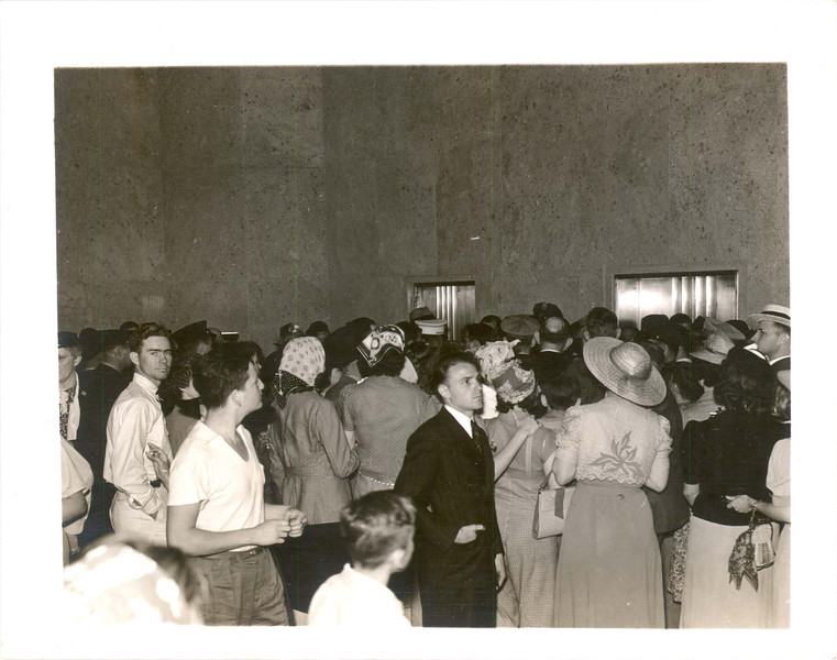 The elevator lobby was just as crowded, with people waiting to go to the top.  Cost of an elevator ticket in 1939: 25 cents for adults, 10 cents for children.  Length of time for the trip in 1939: a minute and a half going up, about 5 seconds less coming down.  A young Houston athelete walked up as quickly as he could, and made the trip up in 15 minutes, and down in 10.