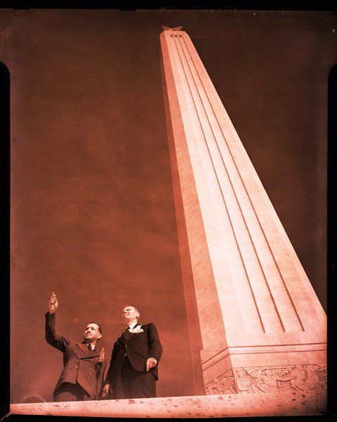 Dick Golding, a member of the organizing committee, and Andrew Jackson Houston, looking toward the water.  They could be looking toward the flotilla of yachts and speedboats that cruised adjacent to the battleground during the celebration, or at the U.S.S. Wichita, which saluted as it passed the Monument on April 20.